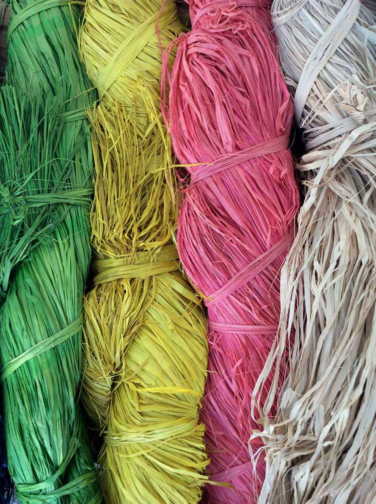 bunches of colored natural raffia straw
