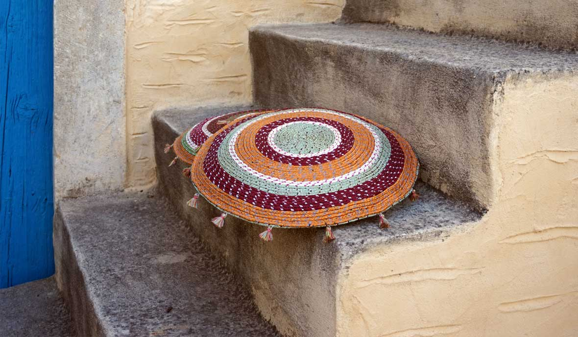 round floor cushion made of colorful ropes