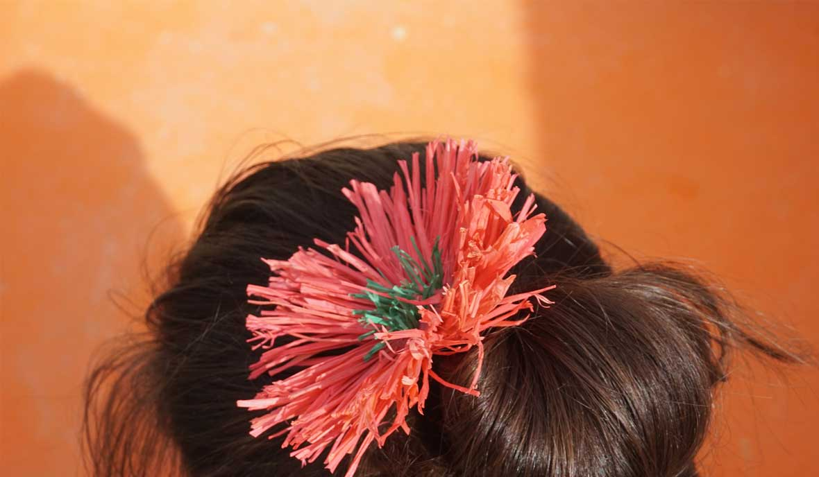 hair tie with pink straw flower